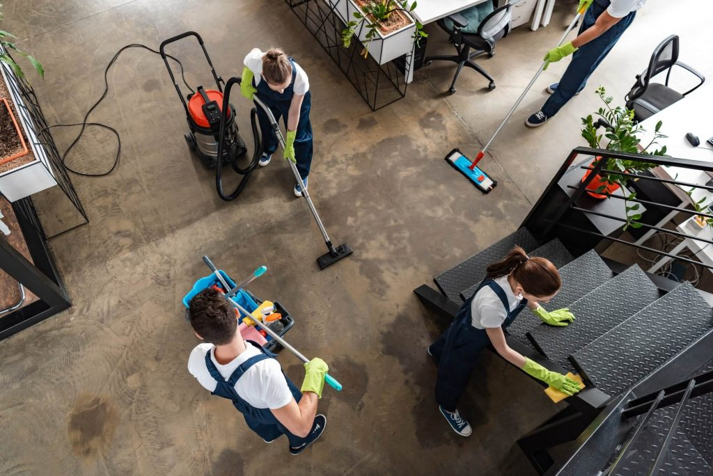 top-view-of-cleaning-company-team-cleaning-modern-office-1-1024x684